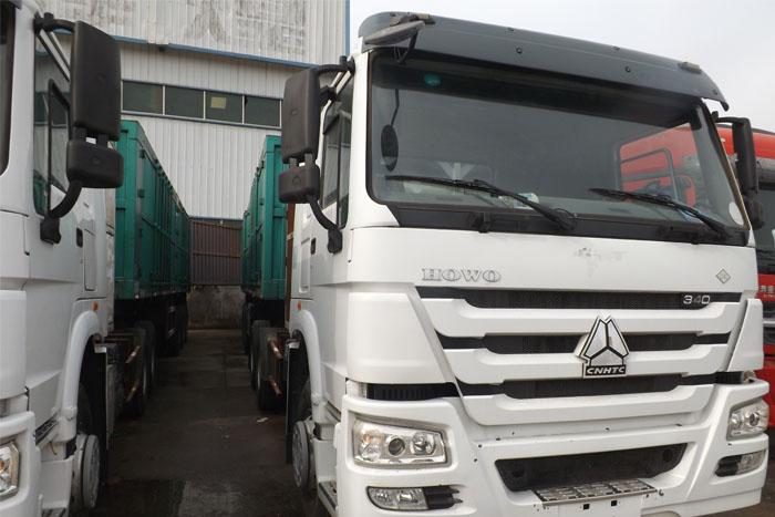 [济宁]2014年国五2014库存中国重汽340马力双驱牵引车 有11米高厢挂车